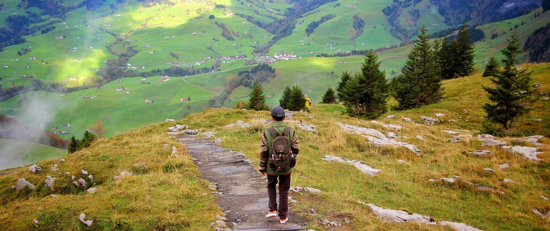 Backpacker trekking in Swiss Alps
