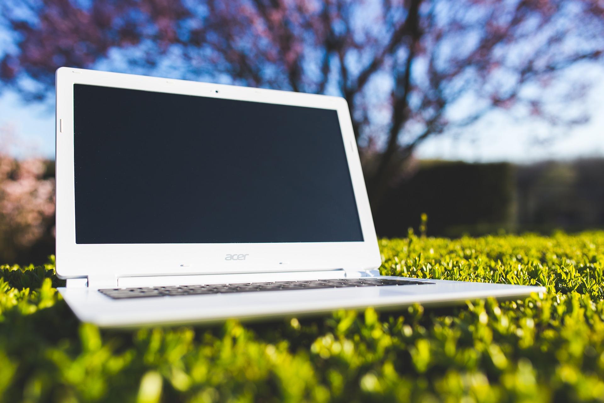 Laptop sitting on grass