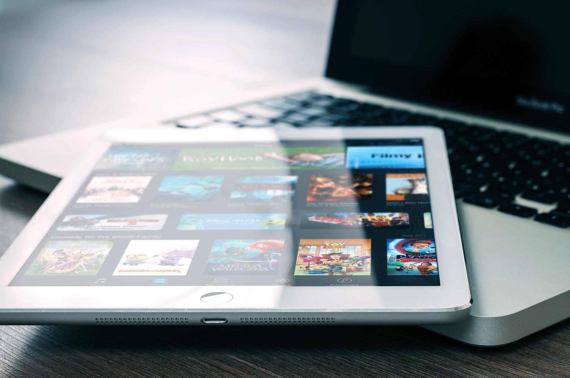 Tablet sitting on laptop