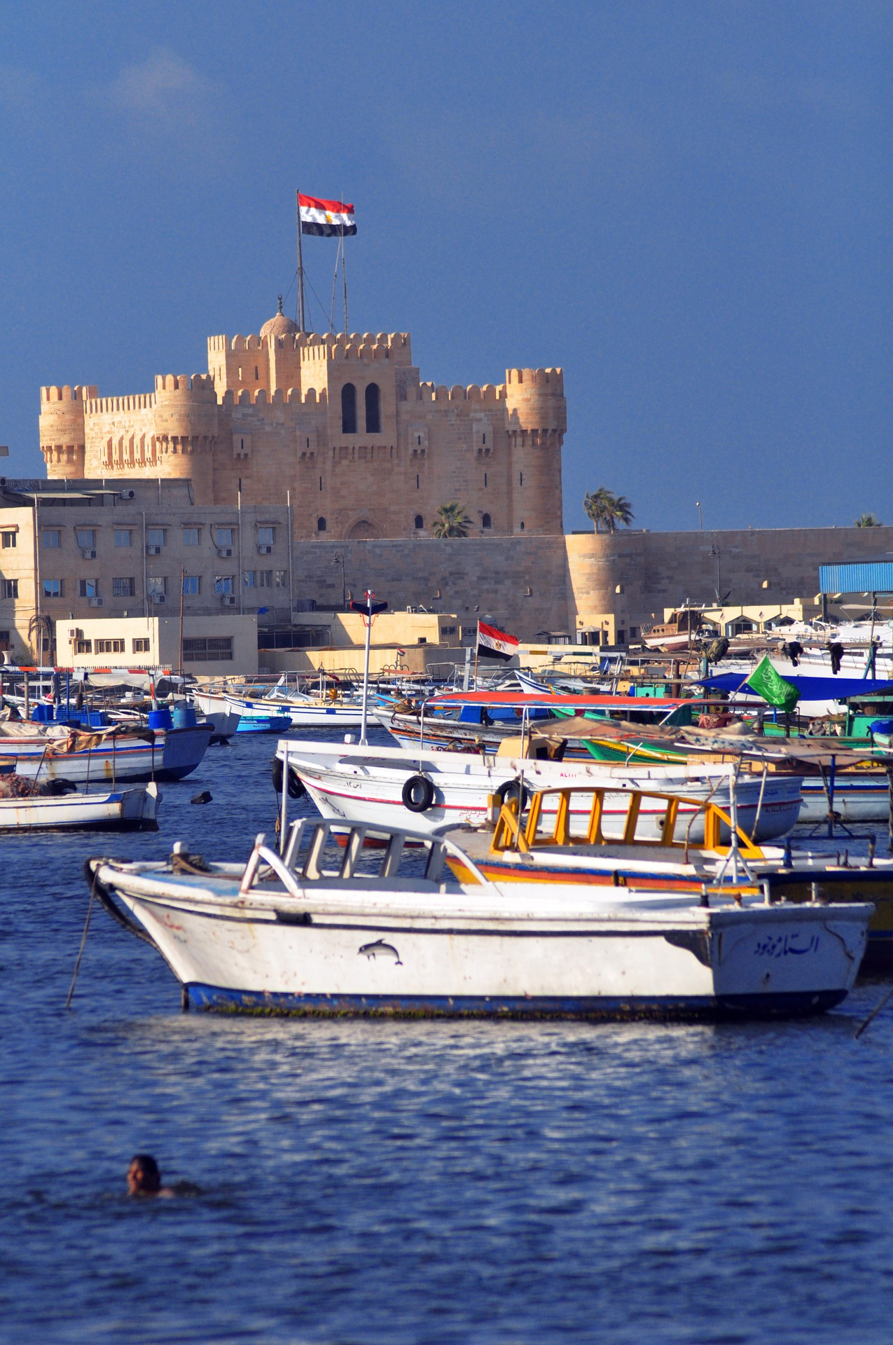 Boats near the Citadel of Qaitbay in Alexandria, Egypt