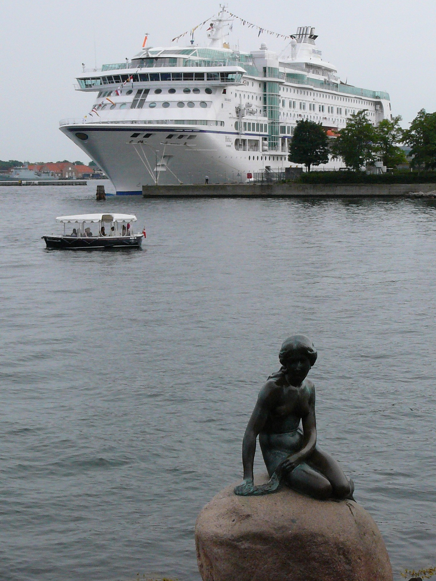 Cruise ship and Little Mermaid statue, Copenhagen, Denmark