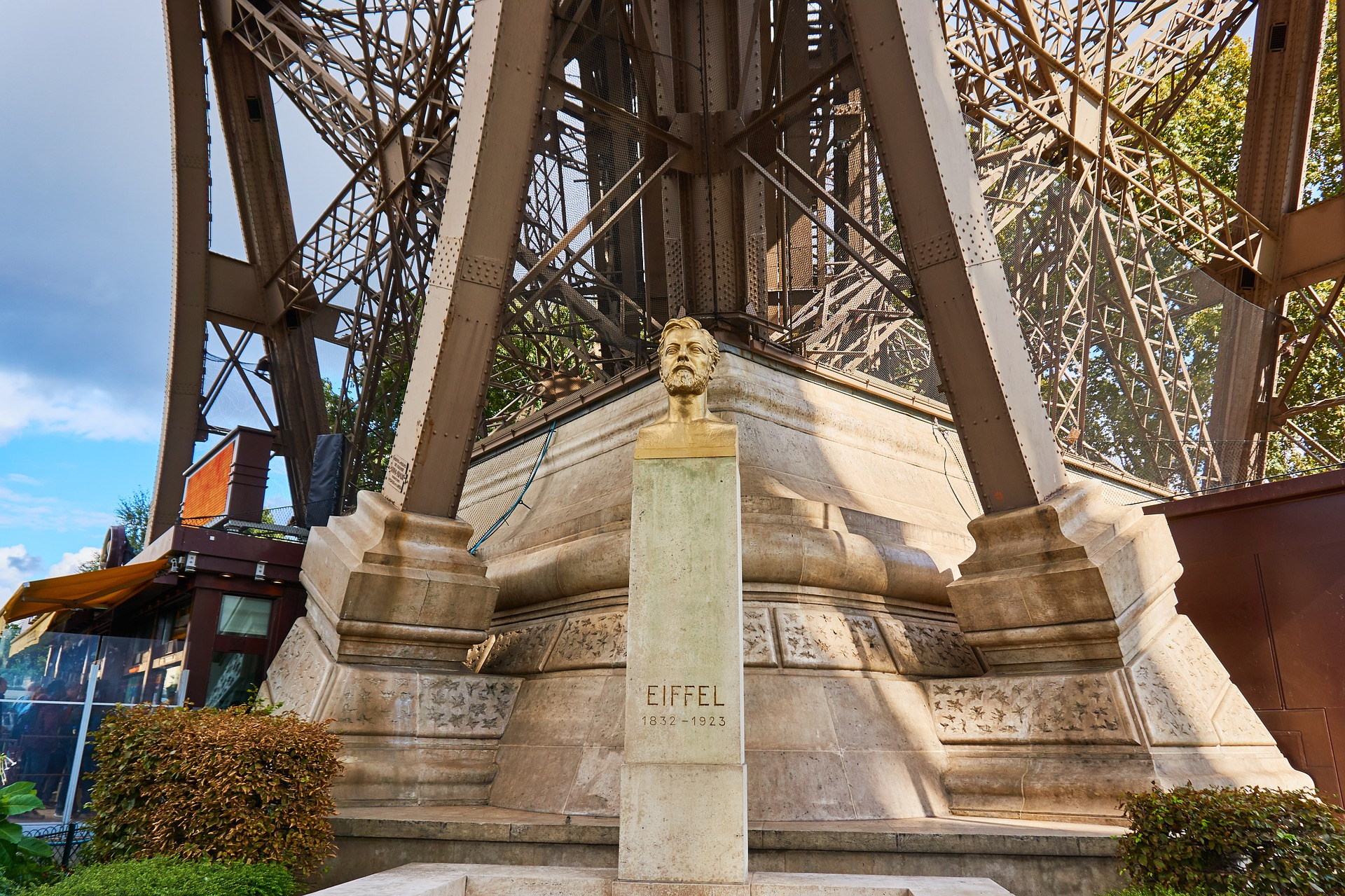 Gustave Eiffel statue in front of the Eiffel Tower in Paris, France
