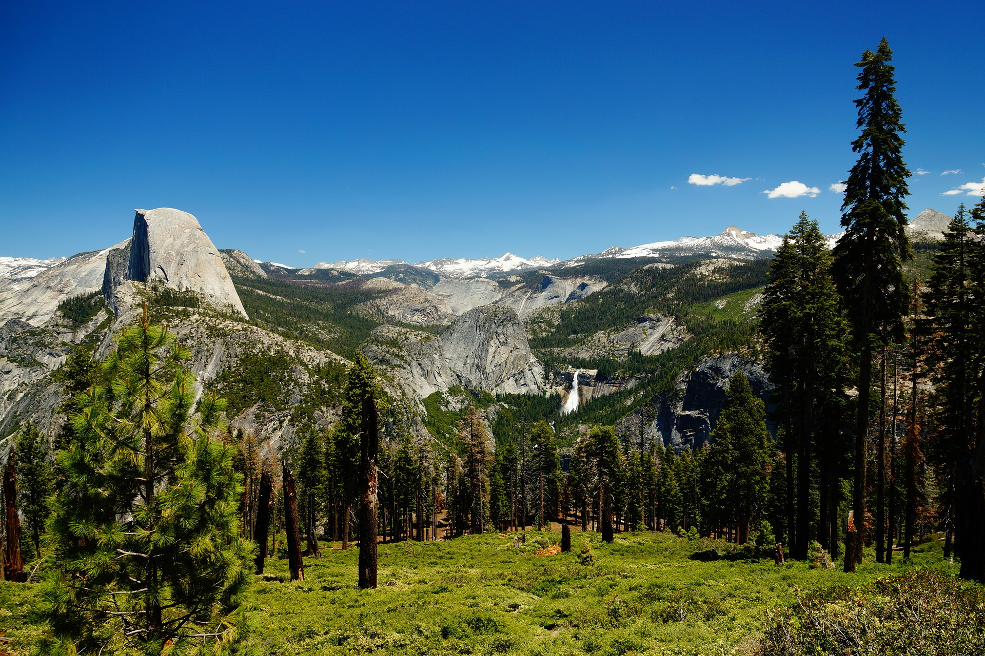 Half Dome (left) and waterfall at Yosemite National Park, California, USA