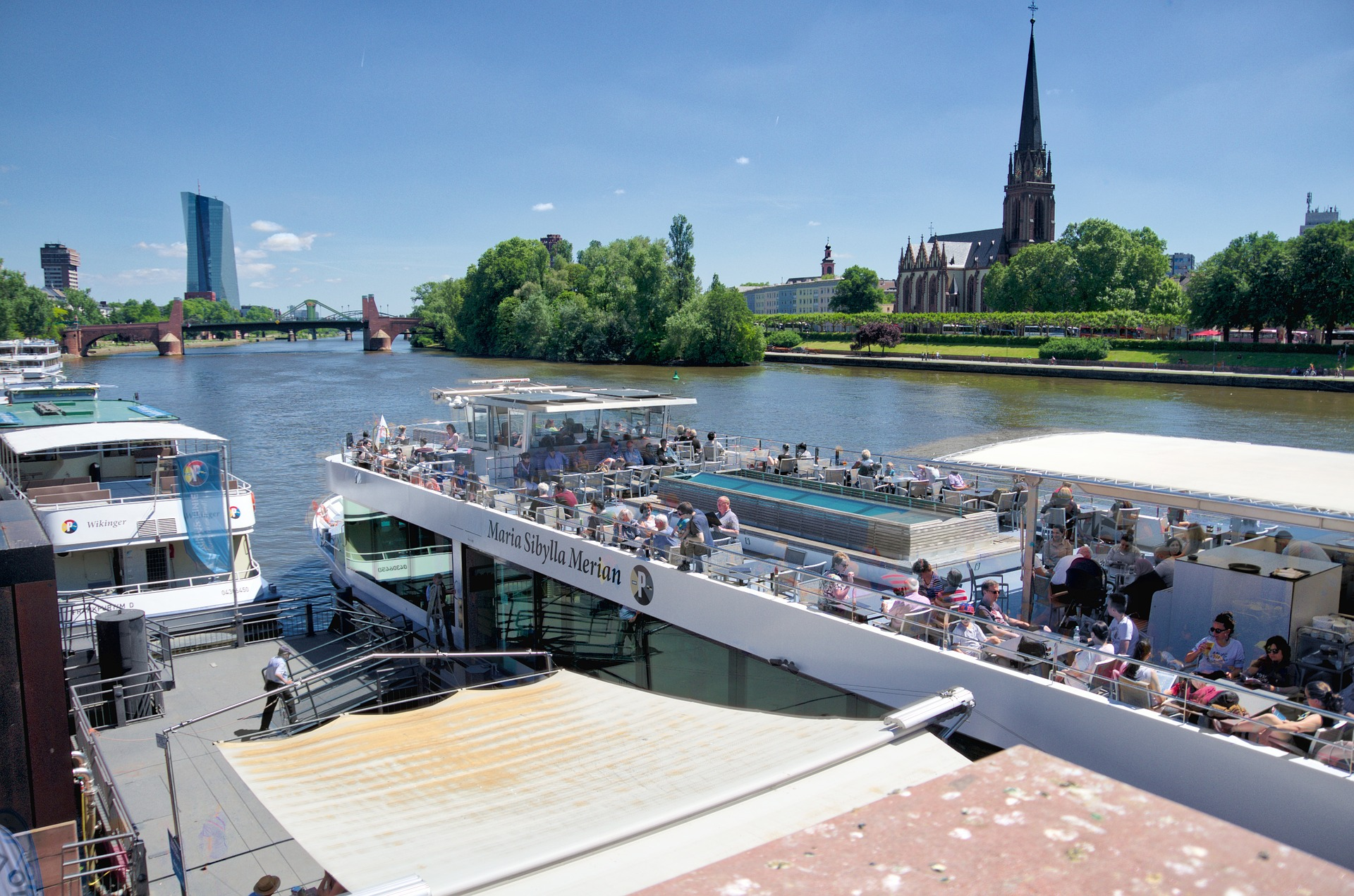 River boat with Dreikönigskirche church in background, Frankfurt, Germany