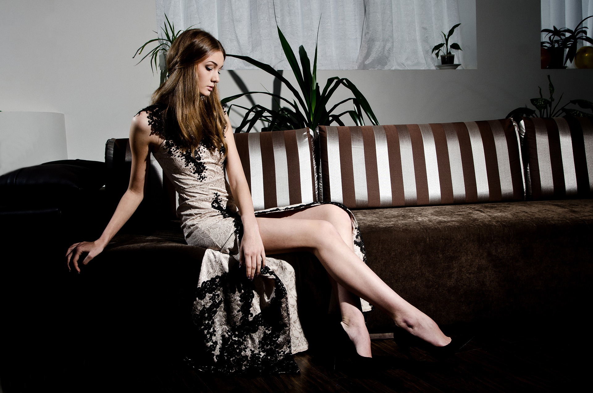 model sitting on chair