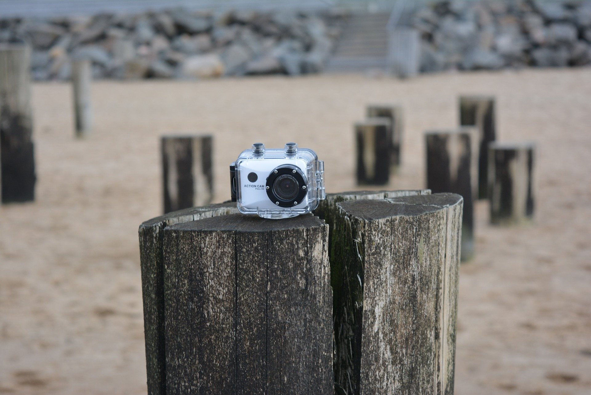 Action camera sitting on wooden column