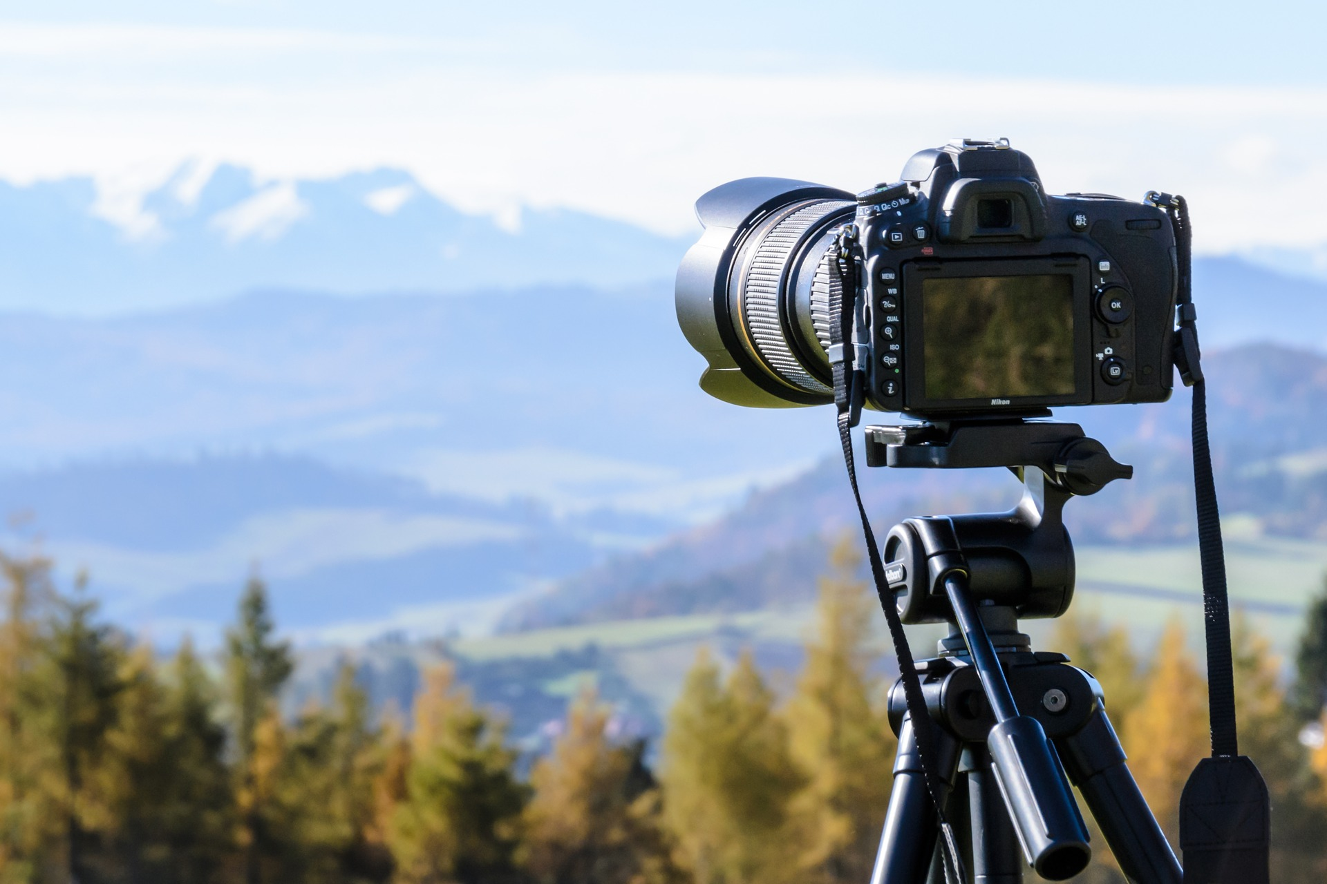 Camera with lens on tripod