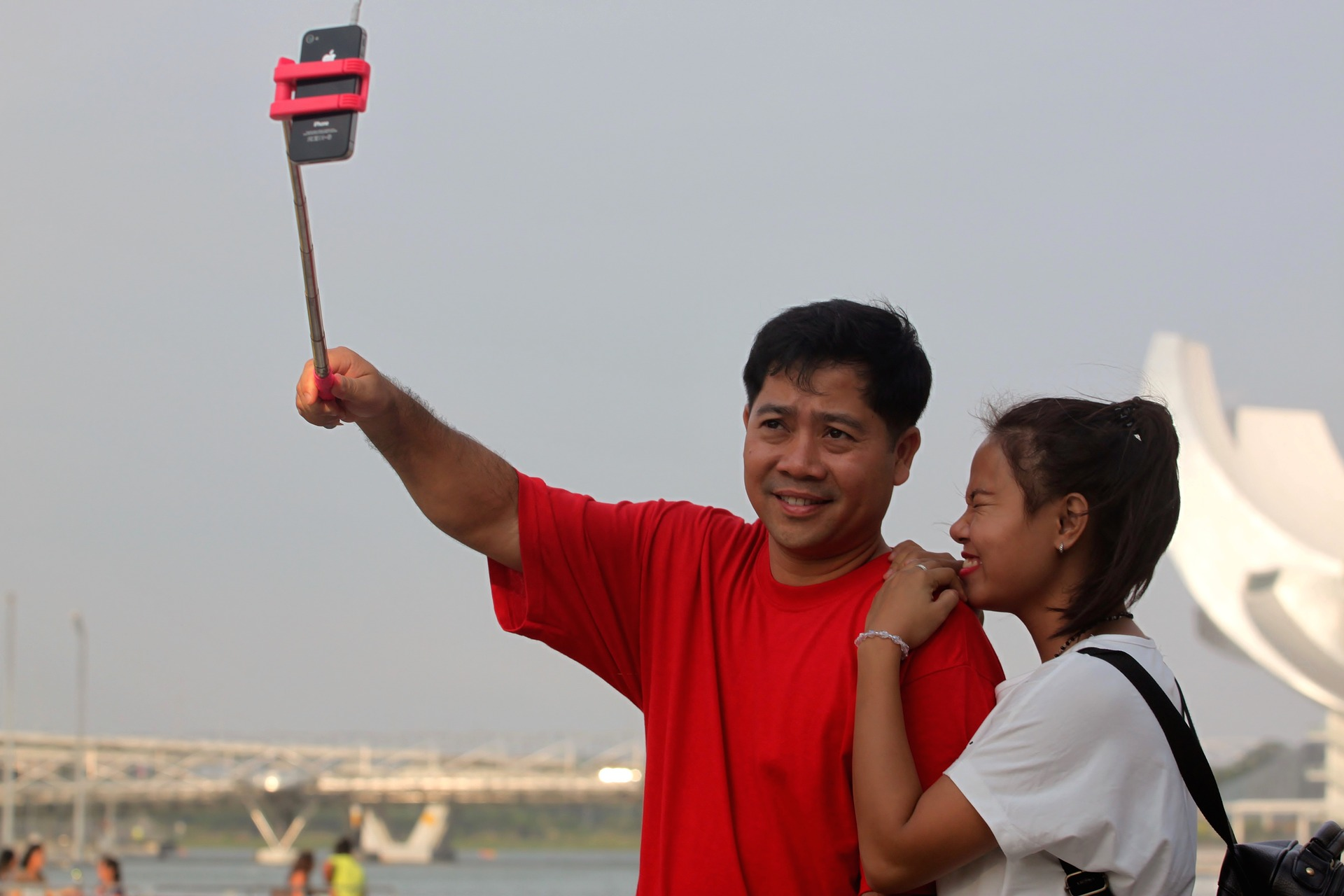 Couple taking photo with selfie stick