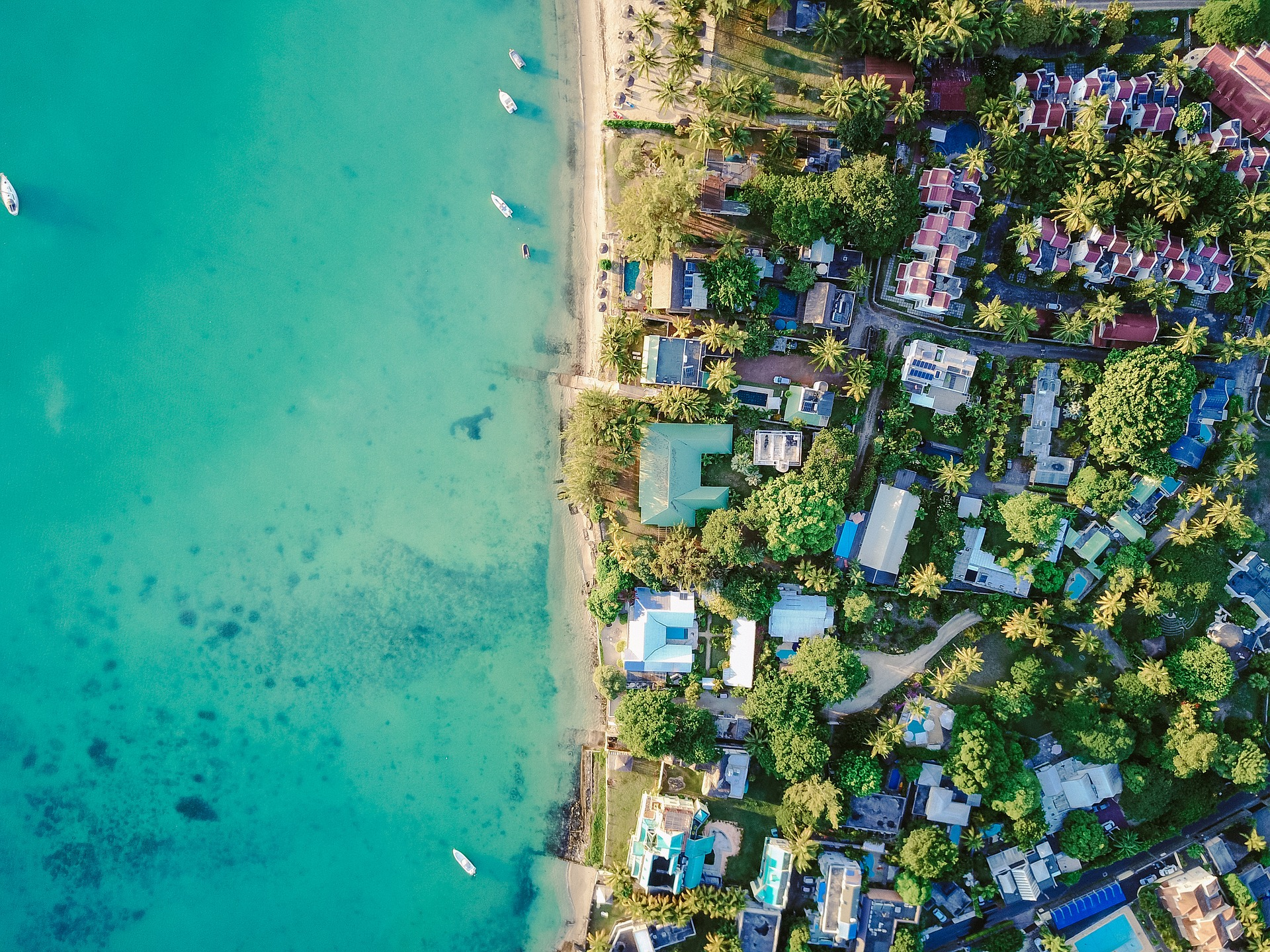 Drone aerial footage of houses close to beach