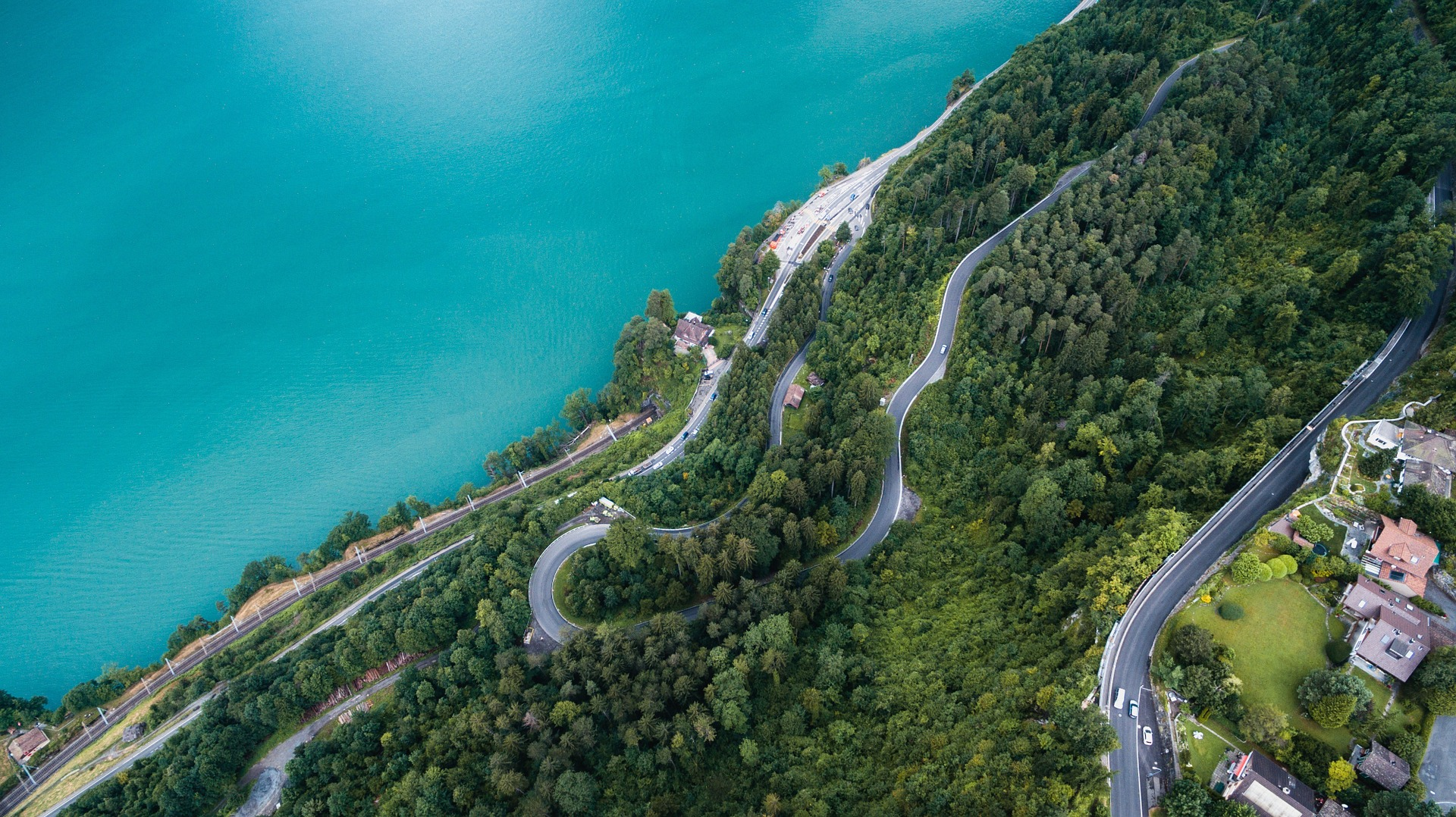 Drone footage of winding road next to sea