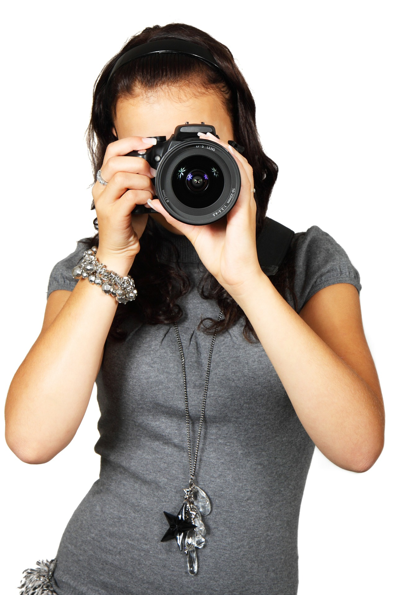 Girl with camera taking pictures