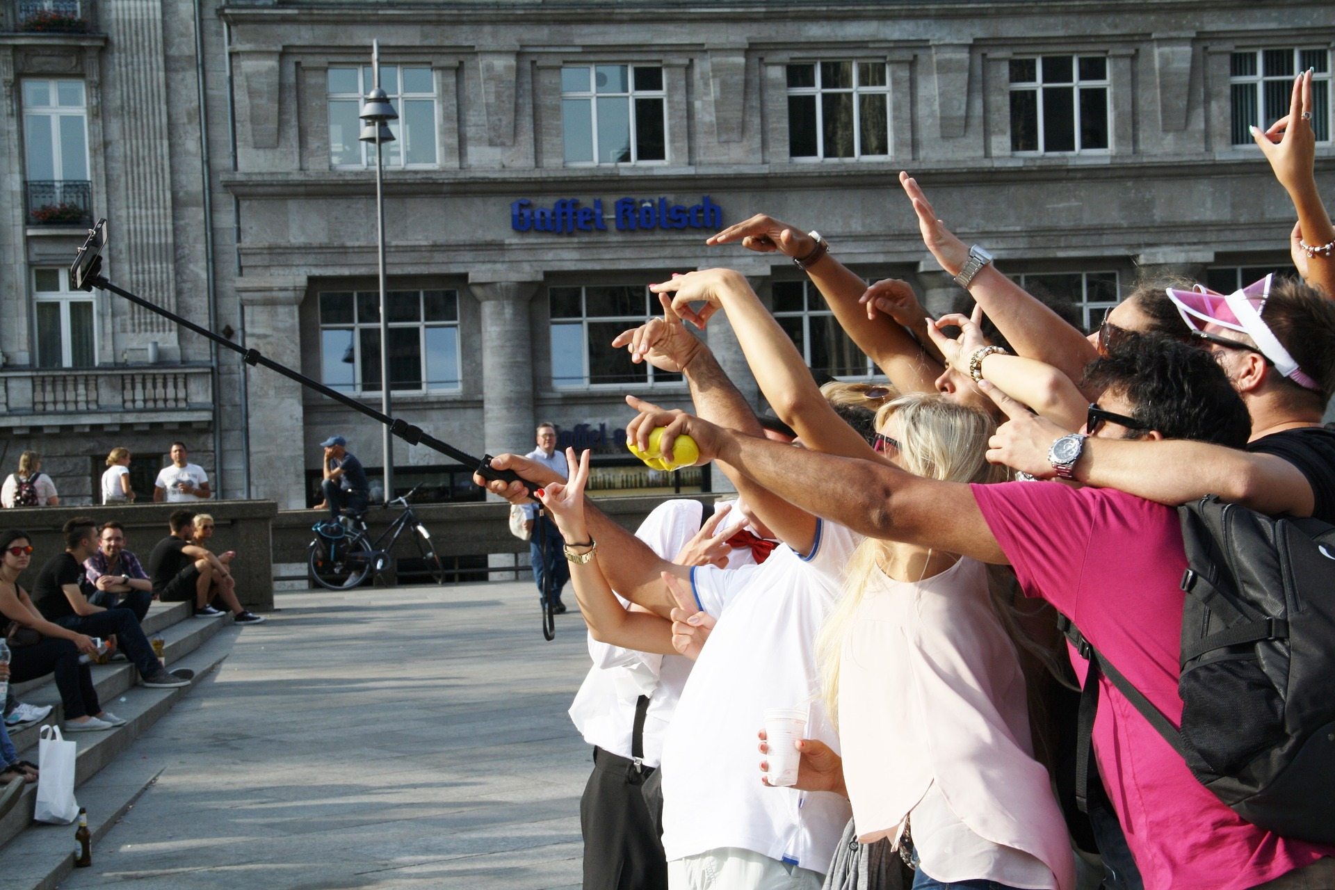 Group of people taking photo using a selfie stick