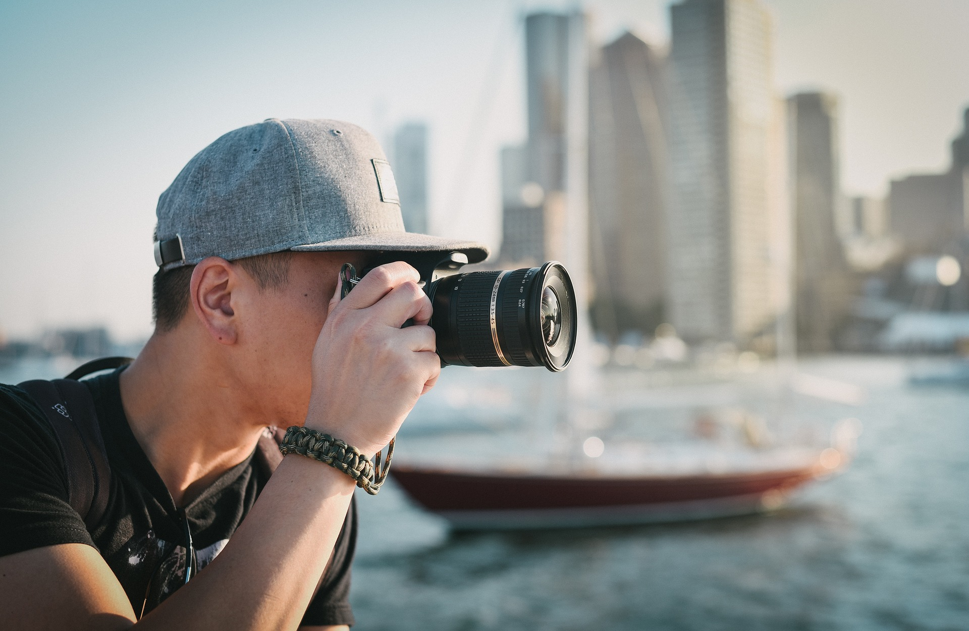 Man holding camera taking pictures
