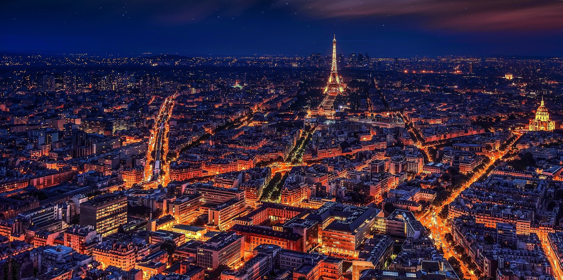 Paris, France at night, with the Eiffel Tower in the center