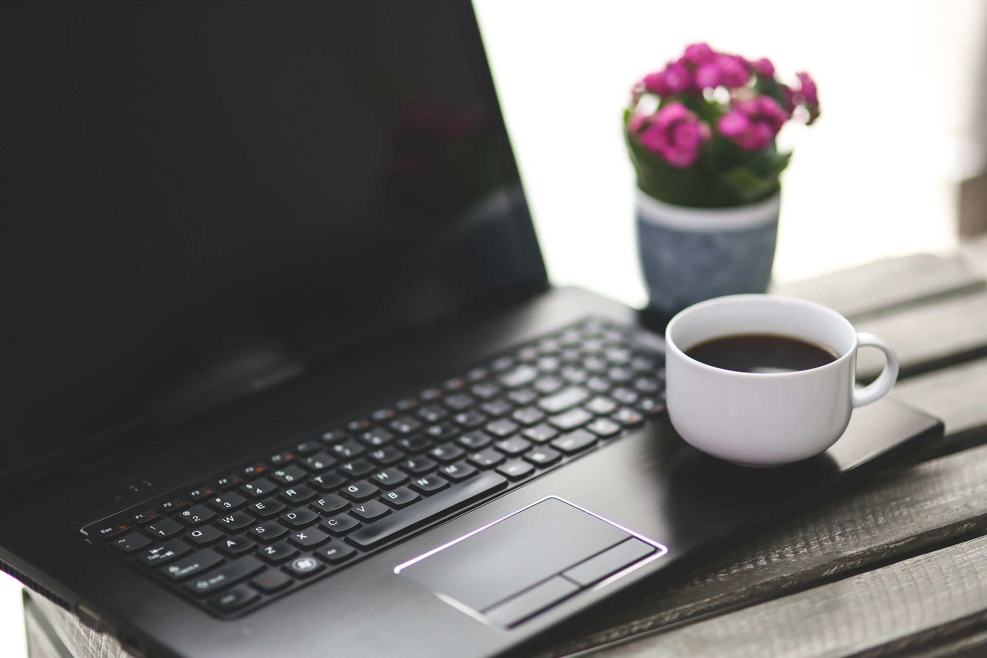 Tea cup sitting on laptop