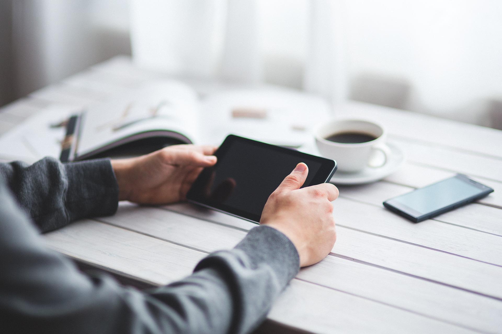 User holding tablet at desk