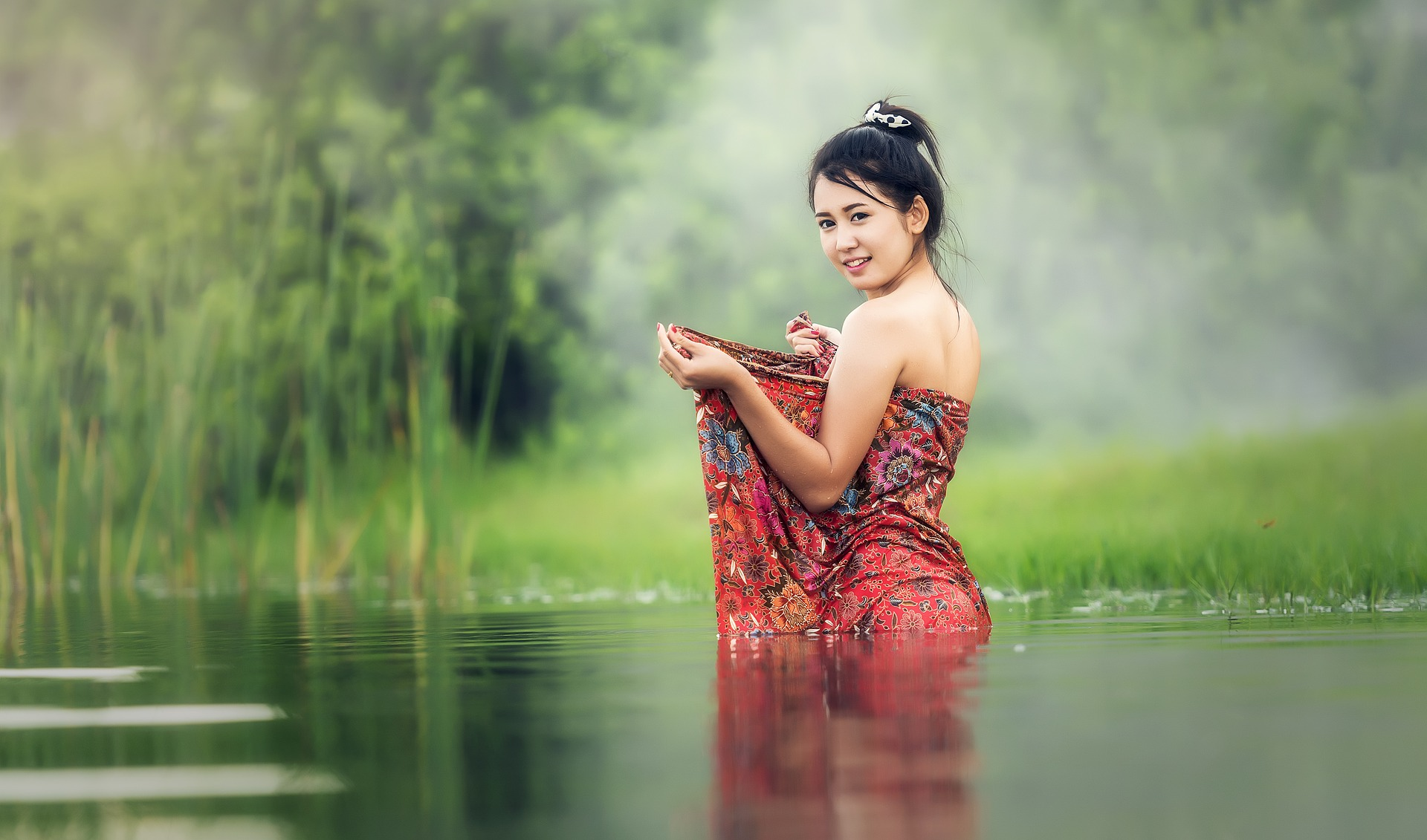 Woman bathing in river in Cambodia