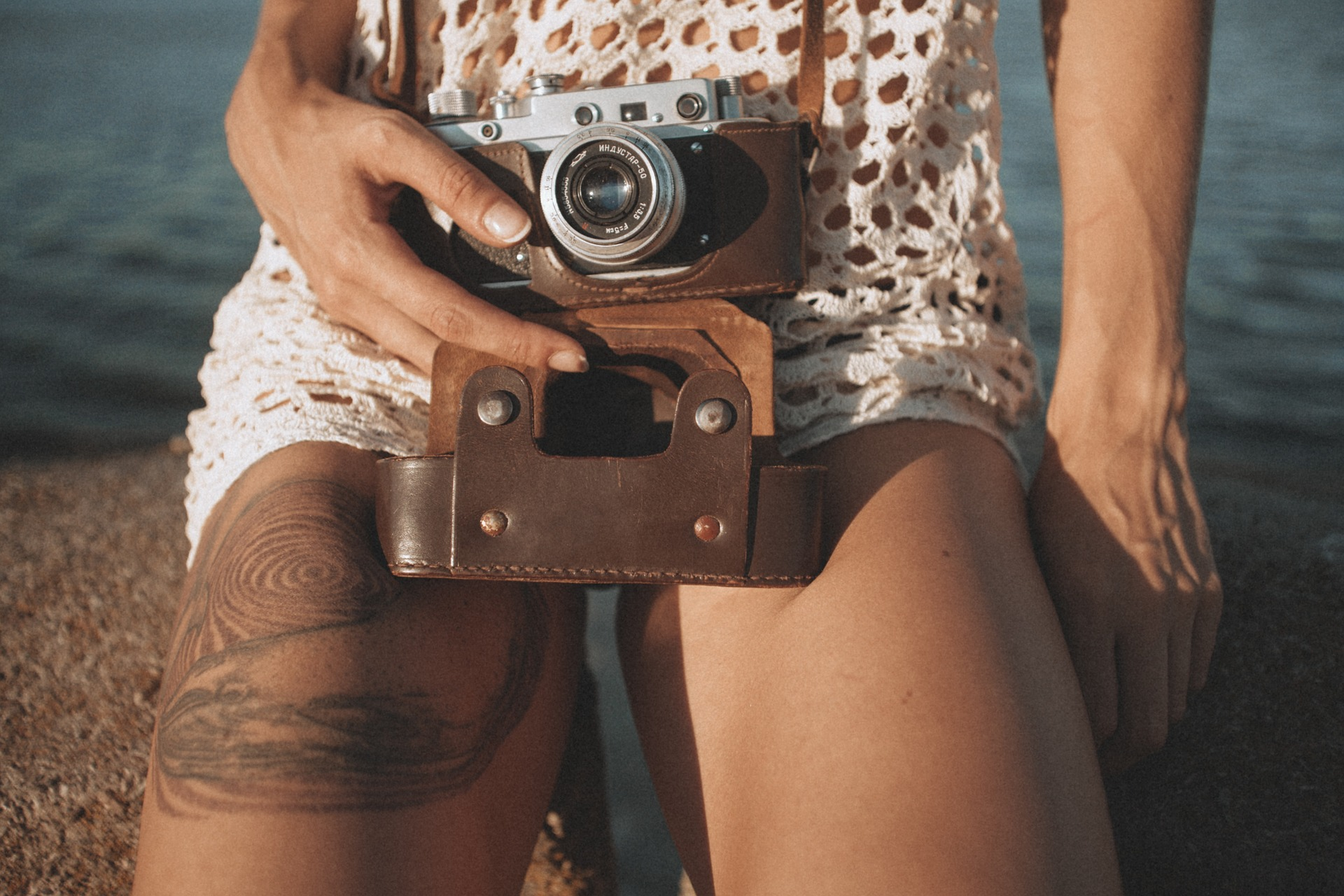 Woman holding camera in her lap