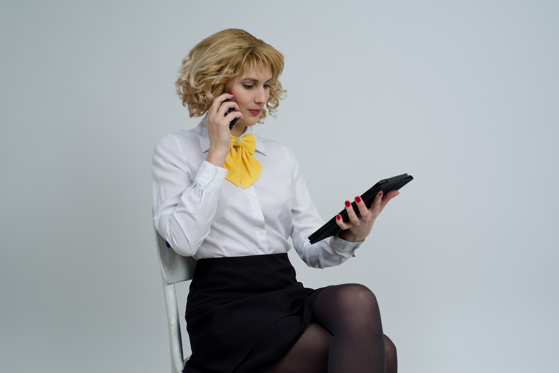 Woman on phone using tablet