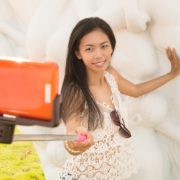Woman taking photo with selfie stick