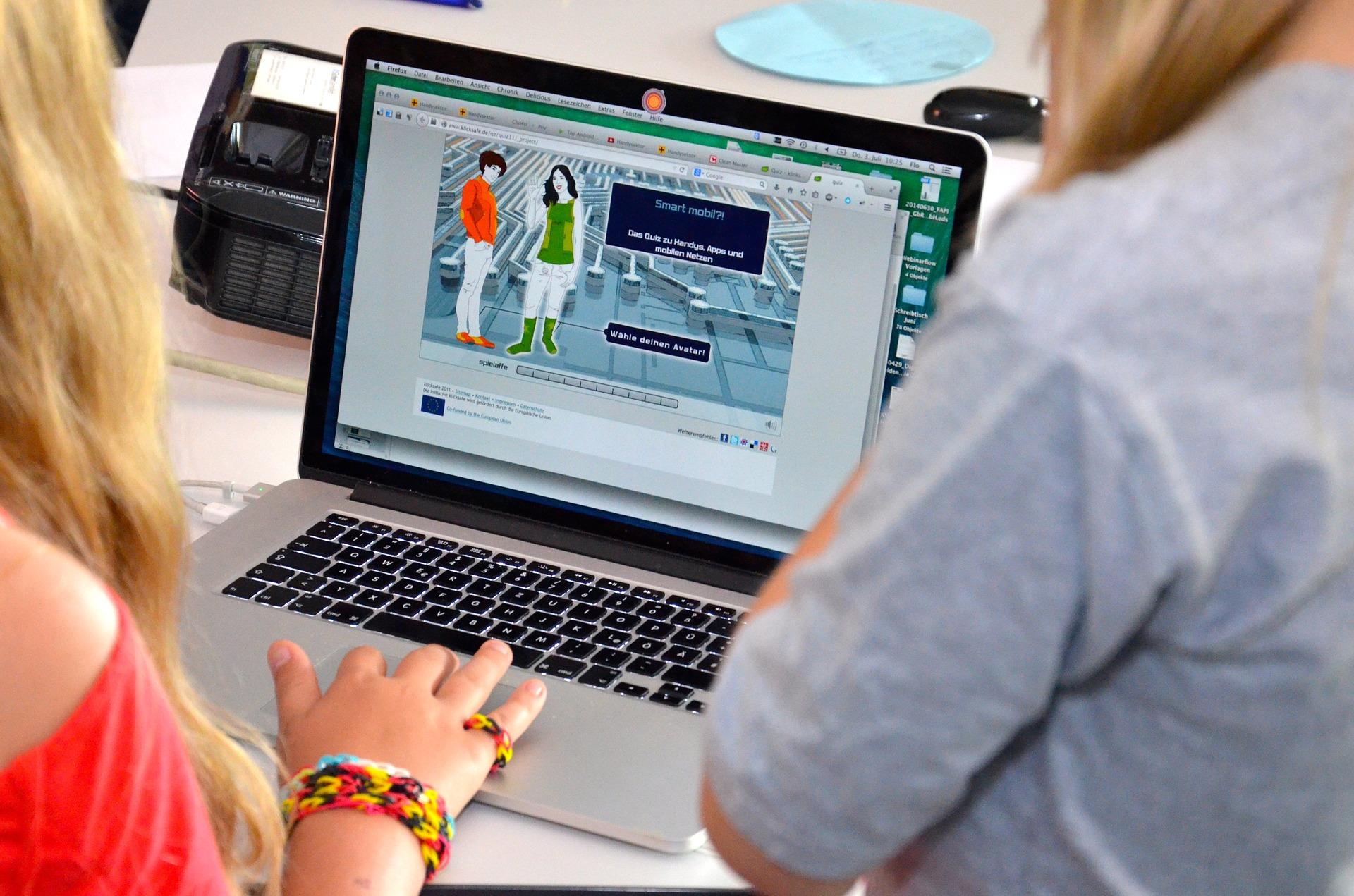 Women browsing content on laptop